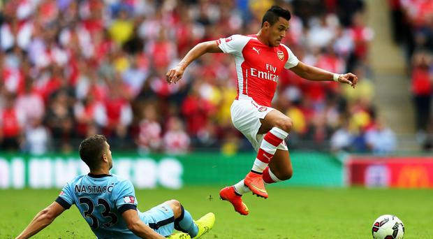 Arsenal's Alexis Sanchez jumps clear of Manchester City defender Matija Nastasic during the Community Shield tie at Wembley. Photo: Clive Mason/Getty Images