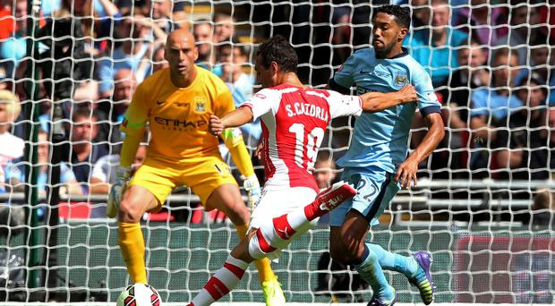 Arsenal's Santi Cazorla scores the opening goal of the Community Shield tie against Manchester City at Wembley. Photo: David Rogers/Getty Images