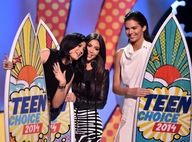 (L-R) TV personalities Kylie Jenner, Kim Kardashian, and Kendall Jenner onstage during FOX's 2014 Teen Choice Awards at The Shrine Auditorium