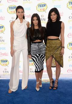 (L-R) TV personalities Kendall Jenner, Kim Kardashian and Kylie Jenner attend FOX's 2014 Teen Choice Awards at The Shrine Auditorium