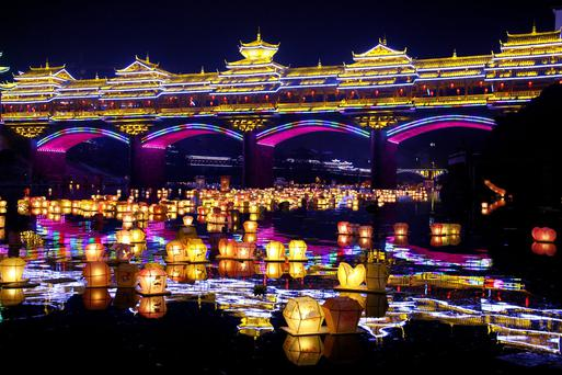 Water lanterns float on a river during Hungry Ghost Festival at Ziyuan County in Guilin, Guangxi Zhuang Autonomous Region of China. People place water lanterns on the river to celebrate Hungry Ghost Festival. Photo by ChinaFotoPress/Getty Images