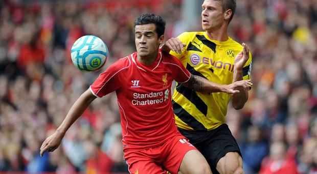 Philippe Coutinho of Liverpool and Lukasz Piszczek of Borussia Dortmund battle for the ball during the Pre Season Friendly match between Liverpool and Borussia Dortmund at Anfield