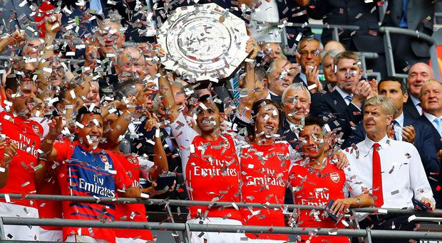 Arsenal's Mikel Arteta (C) lifts the Community Shield after a 3-0 victory over Manchester City during their English Community Shield soccer match at Wembley Stadium