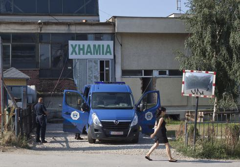 Kosovo police officers guard the entrance of a makeshift mosque after raid in Kosovo capital Pristina on Monday, Aug. 11, 2014. (AP Photo/Visar Kryeziu)