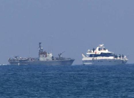 This 2010 image shows an Israeli army military vessel (L) escorting one of the boats in the last ill-fated Gaza-bound aid flotilla
