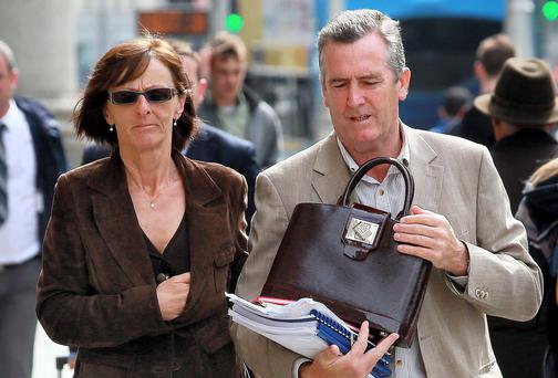 Mary Brennan, from the Park, Cabinteely, Co. Dublin, pictured leaving court yesterday with her husband, Philip, after the judgement in her High Court action for damages. Picture: Paddy Cummins/PCPhoto.ie