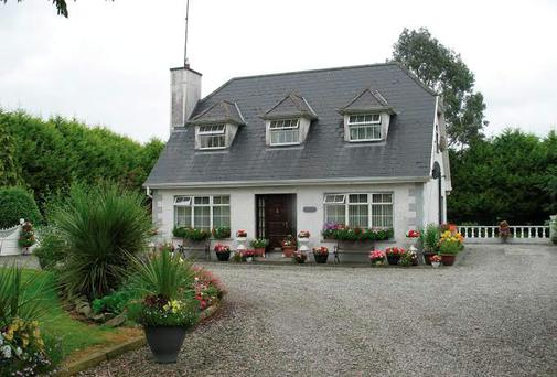 Compact: The sale of Rumshinny dairy farm in Co Meath includes this modern bungalow