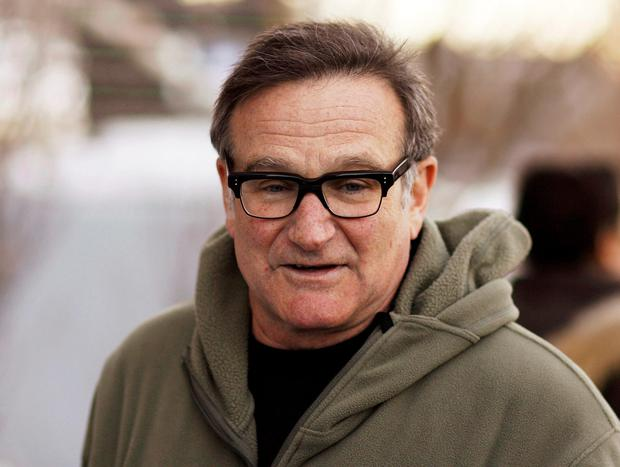 Actor and comedian Robin Williams arrives at the premiere of the film