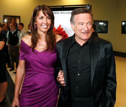"Actor Robin Williams (R), star of the film ""World's Greatest Dad"", escorts Susan Schneider at the film's premiere in Los Angeles, California"