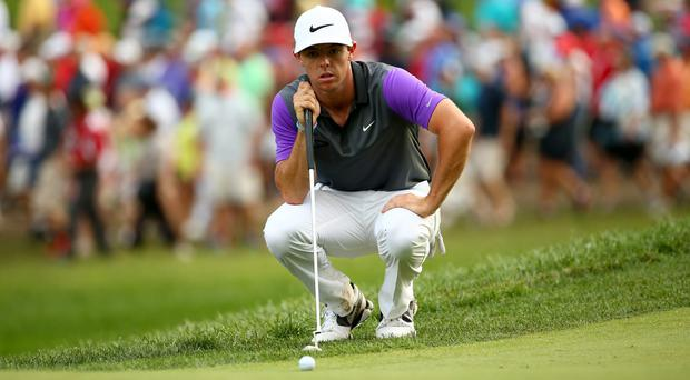 Rory McIlroy lines up a putt on his way to victory at the USPGA. Photo: Andy Lyons/Getty Images