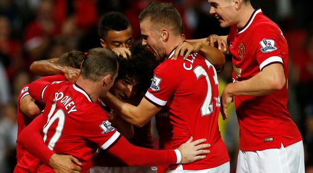 Manchester United's Marouanne Fellaini celebrates after scoring the winning goal against Valencia with his teammates during their pre-season match at Old Trafford.