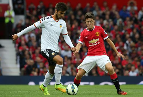 Manchester United midfielder Ander Herrera in action against Antonio Barragan of Valencia during the pre-season friendly match at Old Trafford. Photo: Matthew Peters/Man Utd via Getty Images