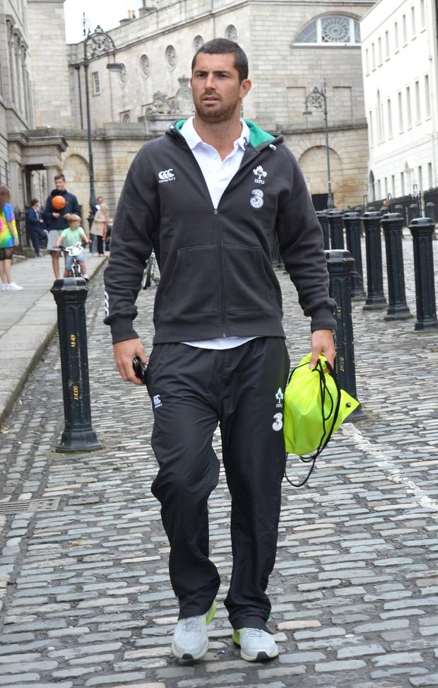 Irish Rugby players Cian Healy, Andrew Trimble, Paul O'Connell, Kieran Marmion, Rob Kearney, and others pose for a photo shoot on Henrietta Street