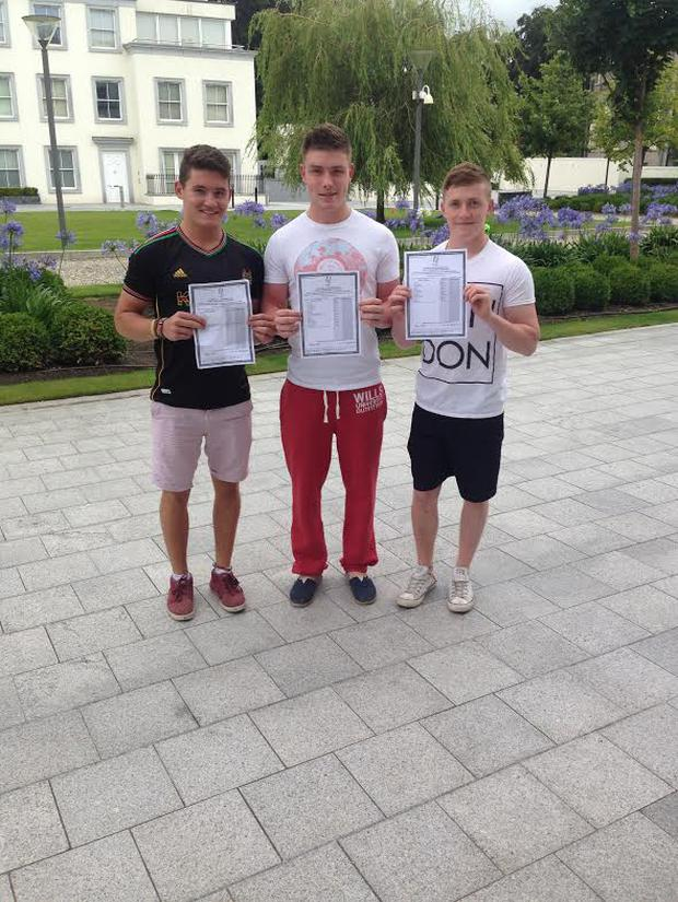 From left to right: Triplets Oisin, Daire, and Tristan as they collected their Leaving Cert results in Blackrock College Dublin.