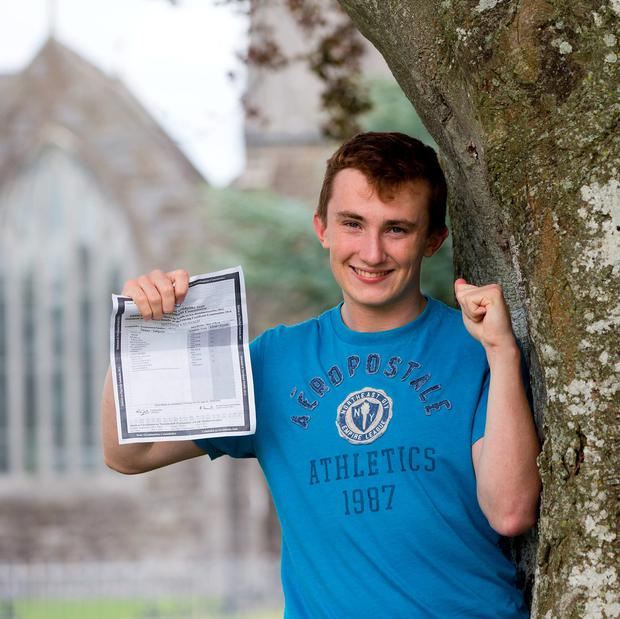 Cistercian College Roscrea student Matthew Kavanagh from Urlingford, County Kilkenny centre, receiving top honours. Photo: Sean Curtin