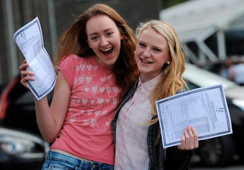 Students from the Presentation college in Tuam who were delighted with their Leaving cert results, pictured are Lisa St. John, Caherlistrane and Nicola Comer, Annaghdown . Photo: Ray Ryan