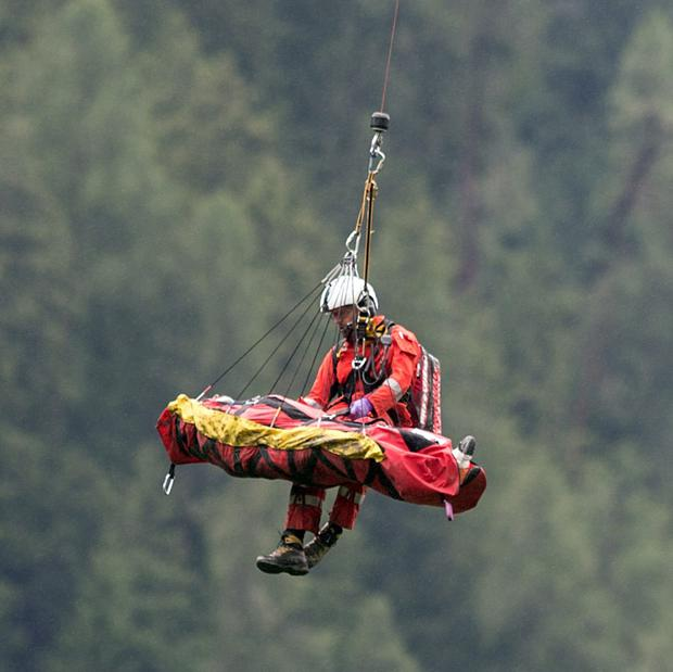 A victim of today's train crash near Tiefencastel, Switzerland, is recovered by helicopter