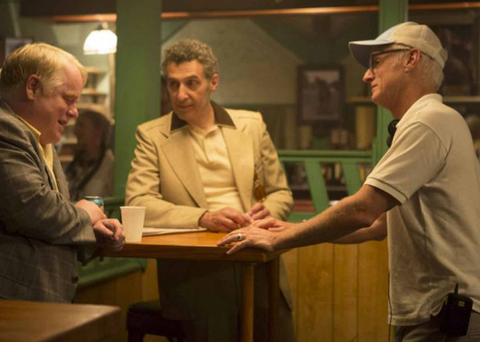 The late Philip Seymour Hoffman (L) on set with John Turturro, and actor/director John Slattery (R)