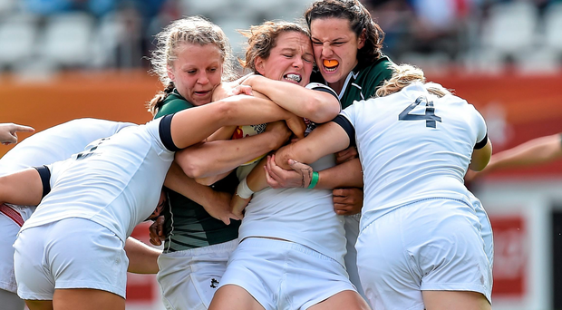 Joanna McGilchrist of England, is tackled by Claire Molloy, left, and Paula Fitzpatrick, Ireland.