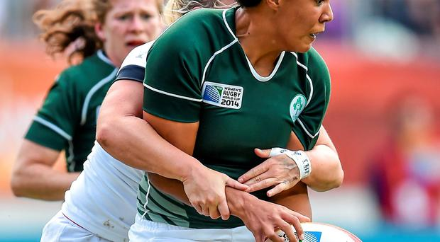 Ireland's Sophie Spence attempts to retain possession after being tackled by Rachael Burford, England. 2014 Women's Rugby World Cup semi-final, Ireland v England, Stade Jean Bouin, Paris, France. Picture credit: Brendan Moran / SPORTSFILE