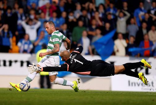 Anthony Stokes gets past St Johnstone goalkeeper Alan Mannus to score for Celtic during their Scottish Premier League match at McDiarmid Park. Photo: Danny Lawson/PA Wire