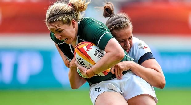 Niamh Briggs is tackled by Emily Scarratt in Ireland's Women's Rugby World Cup semi-final defeat to England in Paris. Photo: Brendan Moran / SPORTSFILE