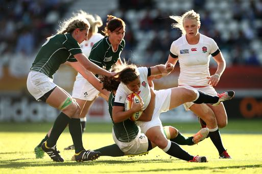 Ireland's Jenny Murphy gets a tackle in on Emma Croker of England during the Women's Rugby World Cup semi-final in Paris. Photo: Jordan Mansfield/Getty Images