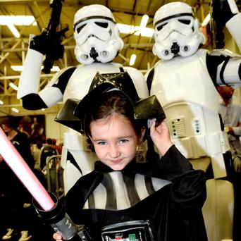 Comic Con in The National Show Center in Swords County Dublin. Jennifer Glynn aged 5 with members of the 501st Ireland Garrison. Pic. Bryan Meade