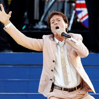 File photograph shows singer Cliff Richard performing during the Diamond Jubilee concert in front of Buckingham Palace in London June 4, 2012