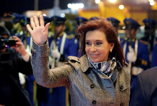 Argentina's President Cristina Fernandez de Kirchner gestures after arriving at the Silvio Pettirossi airport in Luque, near Asuncion August 12, 2014. Kirchner is on a two-day visit to the country to meet with Paraguay's President Horacio Cartes. REUTERS/Jorge Adorno (PARAGUAY - Tags: POLITICS)