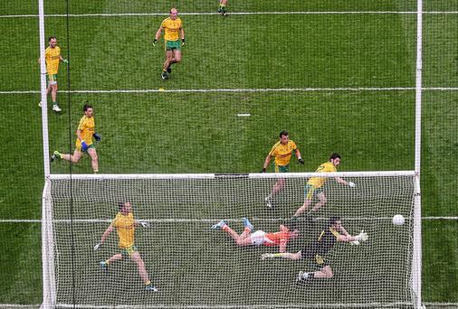 The massed ranks of Donegal defenders can't stop Stefan Campbell scoring a goal for Armagh in last Saturday's All-Ireland quarter-final
