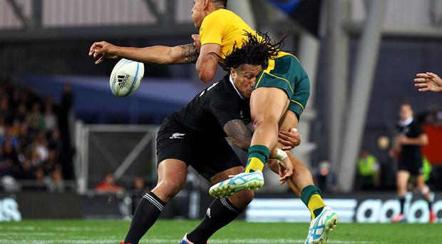 Ma'a Nonu of New Zealand tackles Israel Folau of Australia during The Rugby Championship match between the New Zealand All Blacks and the Australian Wallabies at Forsyth Barr Stadium last year. The Wallabies stand in the way of an 18th straight win for the All Blacks which would set a new world record. Photo credit: Anthony Au-Yeung/Getty Images