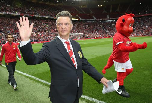 Manager Louis van Gaal of Manchester United waves to the crowd ahead of the Pre Season Friendly match between Manchester United and Valencia at Old Trafford