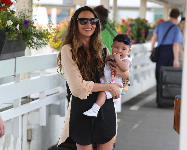 Nadine Coyle seen arriving back at Heathrow Airport from Los Angeles with her daughter Anaiya