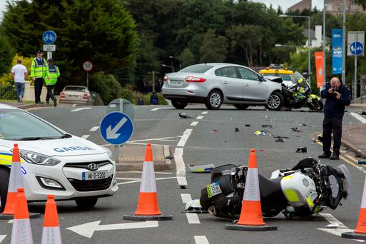 The scene at the junction of Clarion road and the Manorhamilton road in Sligo, yesterday, where a car collided with two motorcycle Gardai. Photo: James Connolly / PicSell8