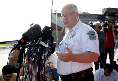 Ferguson Police Chief Thomas Jackson releases the name of the the officer accused of fatally shooting an unarmed black teenager AP Photo/Jeff Roberson