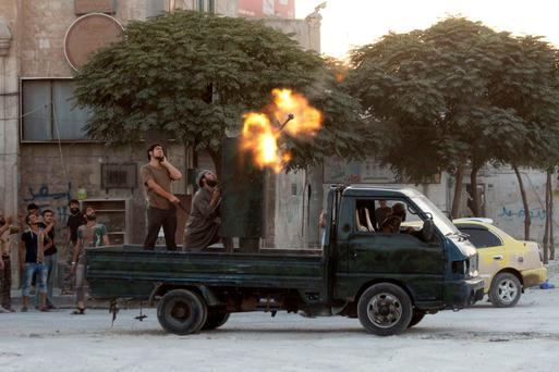Free Syrian Amy fighters fire their weapon towards warplanes loyal to Syria's President Bashar al-Assad in the Qadi Askar district of Aleppo. Reuters