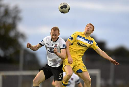 Shane Duggan, Limerick FC, in action against Chris Shields, Dundalk