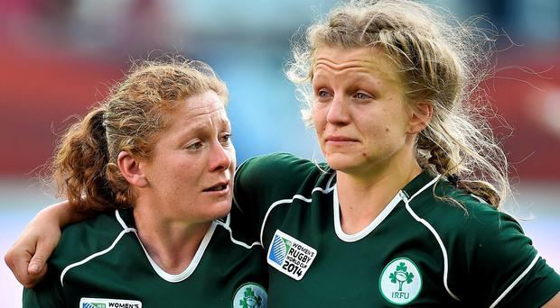 A tearful Grace Davitt, left, and Claire Molloy, Ireland, after their 2014 Women's Rugby World Cup semi-final defeat (Brendan Moran / SPORTSFILE)