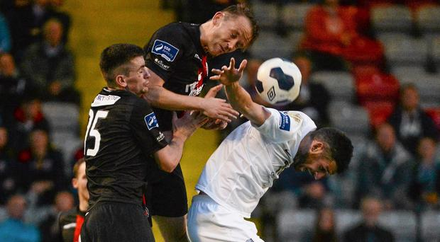 Daniel Byrne, left, and Aidan Price, Bohemians, in action against Gavin Brennan, Drogheda United