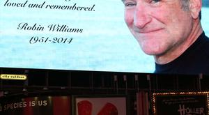 Times Square pays tribute to Robin Williams as Broadway dims the lights to honor his life and career on August 13, 2014 in New York City. (Photo by Walter McBride/Getty Images)