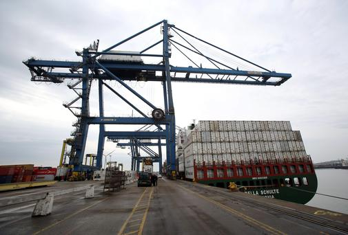 "A man has died and other people have been taken to local hospitals with ""significant health problems"" after 31 adults and children were found inside a shipping container at Tilbury Docks in Essex"