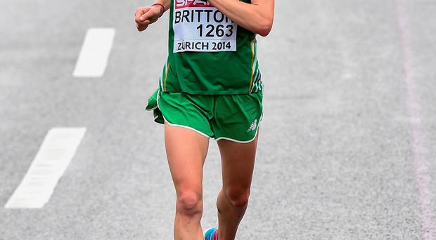 Ireland's Fionnuala Britton crosses the line to finish 10th in the women's marathon. Picture credit: Stephen McCarthy / SPORTSFILE