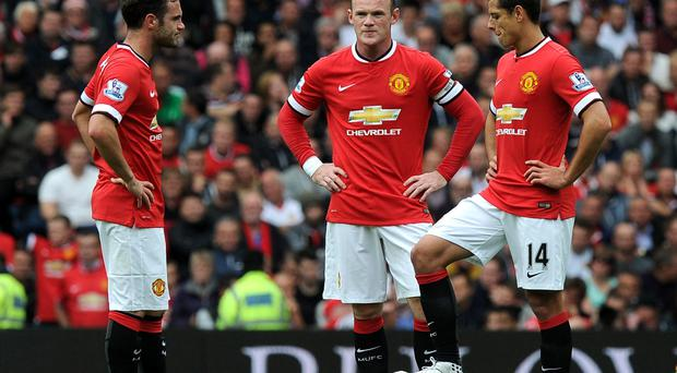 Manchester United's (left to right) Juan Mata, Wayne Rooney and Javier Hernandez dejected at the restart after Swansea City score during the Barclays Premier League match at Old Trafford