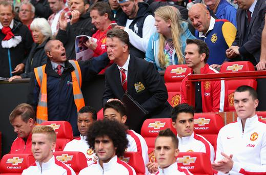 Manchester United Manager Louis van Gaal takes his seat