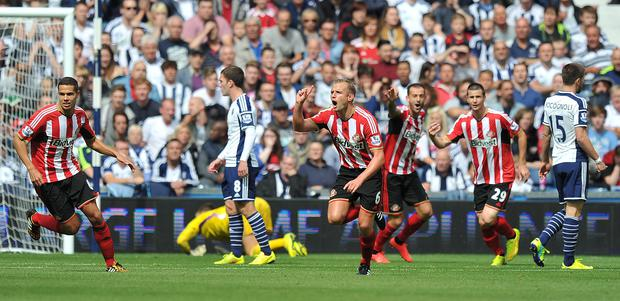 Sunderland's Lee Cattermole celebrates scoring his team's first goal during the Barclays Premier League match at The Hawthorns