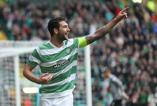 Charlie Mulgrew of Celtic celebrates after he scores during the Scottish Premiership League Match between Celtic and Dundee United
