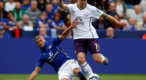 Leicester City's Paul Konchesky (L) challenges Everton's Aiden McGeady their English Premier League soccer match at the King Power stadium in Leicester