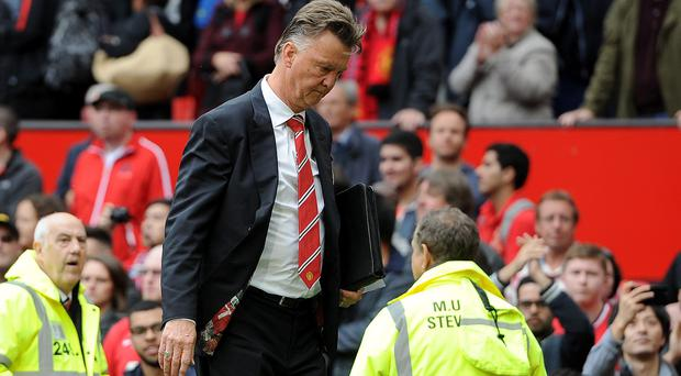 Manchester United manager Louis van Gaal leaves the pitch after his teams 2-1 defeat against Swansea City, during the Barclays Premier League match at Old Trafford