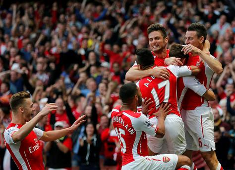 Arsenal's players celebrate Aaron Ramsey's goal